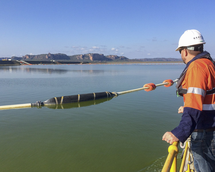 Floating rubber dredge suction hose in a tailings pond